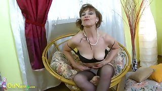 Adult lady is playing with her body slowly stripping down and exposing her natural curves